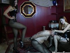 These two gorgeous mistresses cross-dress their slave and kick him in the balls with heels on. They torture his cock as well, spank his ass and sit on his face.