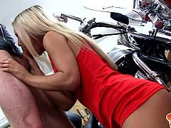 If you number yourself among Sabrina's admirers, don't miss these hot scene, where she reveals seductive charms to a biker boy. The hot blonde unzips her red short dress, showing a pair of nice small tits. The slutty babe sucks dick, sitting on knees. Watch the couple giving in to lusty desires on the floor.