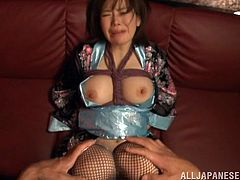 Have a good time by watching this Asian brunette, with natural boobs wearing fishnet stockings, while she gets touched with a vibrator.