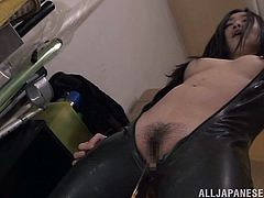 Japanese babe Ryu wears a sexy leather outfit as she gets her yummy hairy pussy licked and gives the horny guy a hot blowjob.