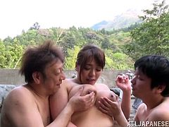 Check this reality video where An Asian cougar, with big knockers and juicy lips, while she gets fucked hard in a wild threesome outdoors.