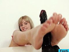 Get a load of Bella Anne's beautiful oiled up feet in this solo scene where this naughty cutie chows off her footjob abilities on a large dildo.