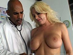 Get a hard dick by watching this blonde cougar, with big love pillows wearing a miniskirt, while she gets drilled hard in a hospital room.