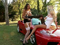 Dude, what can be more sexy that two lascivious well-stacked lesbians having fun on the red Ferrari? I think that nothing can be. Just check out this mischievous girls!