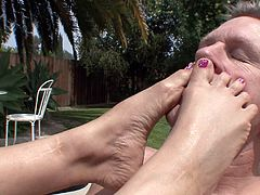 Mark Wood is having a great time with hot blonde Lexi Love, wearing high heels. Lexi sucks and rides Mark's schlong on the poolside, then shows her footjob skills to the stud.