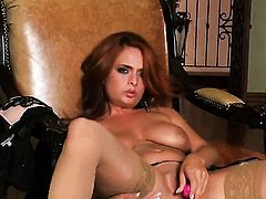 Ashley Graham with gigantic tits and bald beaver toying her cunt