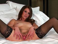 Enjoy this solo model video where a brunette beauty, with natural breasts wearing nylon stockings, while she touches herself until she cums.