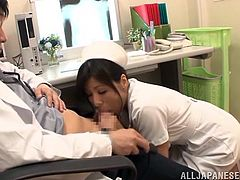 Horny Japanese nurse Azusa Ishihara gives the lusty doctor a sexy blowjob under his desk and ends up taking his hard cock from behind.
