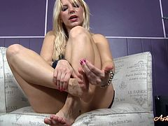 Take a look at Ashley Fires's beautiful feet in this solo scene where she'll definitely give you one hell of a boner as you watch.
