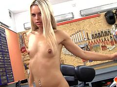 Beautiful blonde lady Sabrina Blond is in the garage and posing sexily by the Harley Davidson motorcycles. She flashes her round butt cheeks towards the camera, and then she leans up against the wall and starts to play with her pussy.
