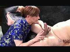 Brunette shemale smokes and sucks a hard cock