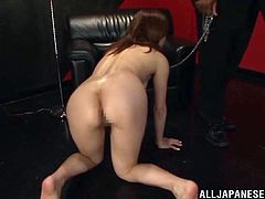 Get a boner by watching this Japanese lady, with natural tits wearing a cute dress, while she masturbates sitting on a leather couch.