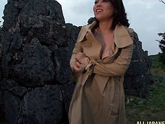 Get a load of this amazing solo scene and take a look at this Japanese babe's big natural tits while she masturbates outdoors with a dildo.