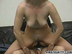 Chubby brown-haired woman, wearing jeans, is getting naughty with a guy indoors. She pleases the man with a blowjob and they fuck in the reverse cowgirl pose.