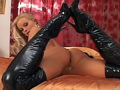 Silvia Saint takes off her outfit before masturbating with a dildo