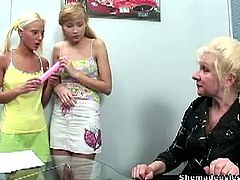 Kristina and Mira were interrupted by their granny teacher and wants to join in with them for some lesbian sex action. She taught them how to use a double dildo for their pleasure.
