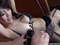 Sexy Japanese bitch Yuuka Tachiban, wearing thong and a bra, allows a guy to rub her twat with a dildo. After that the man stuffs Yuuka's pussy with a vibrator and watches her enjoying it.