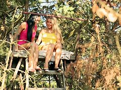 Bailey Ryder and Ines Rozehnalova are playing lesbian games in a forest. The sluts caress each other and make out tenderly, then finger and lick each other's shaved snatches.