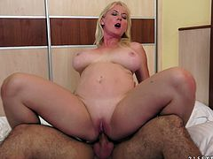 Check out Monik's big natural tits in this hardcore scene where this horny mature blonde is fucked by this guy as she moans.