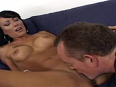 Gorgeous cougar Zoey Holloway gives this guy the hottest titjob and gets a yummy doggystyle fuck on the couch before she takes a big load of cum.
