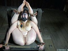She's beautiful and her beauty demands a special treatment! Our blonde has a superb body and the executor loves to punish it. He tied her in the most uncomfortable position, used a mask to control her breathing and then spanked her thighs and ass. Curious what other special things he prepared for her?