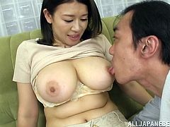 The gorgeous Japanese babe Suzuna Komiya gets her incredibly big natural tits sucked while she enjoys a naughty finger up her hairy pussy.