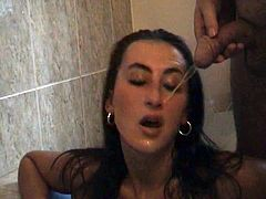 A gorgeous brunette with long hair, big tits and an awesome body enjoys drinking piss and playing with her shaved pussy.