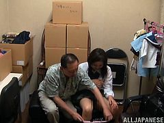 Make sure you check out this hot scene where this horny Japanese babe being masturbated by this guy in a storage room.