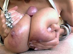This brunette MILF is one hot mama for an oiled tits and a hardcore blowjob.