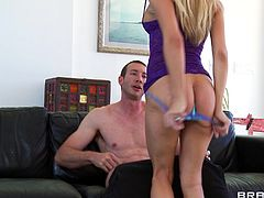 A pretty blonde with long hair, huge fake tits and a fabulous ass enjoys a hardcore doggy style fuck in her living room.