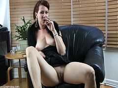 Lewd redhead mom is having fun in smoking fetish solo clip. She smokes a cigarette and flashes her natural boobs and cunt, then entertains herself by masturbating her pink slit.