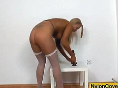 Click to watch this long haired chick, with natural jugs wearing high heels, while she touches herself and plays with her nylon pantyhose.