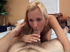 Delectable light-haired babe takes off her clothes demonstrating her big natural boobs. Thereafter she lies on her body side and provides cocky bastard with amazing blowjob.
