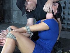 Have a look at beautiful India, tied so nicely and tight and sitting there on her ass, waiting for her punishment. She doesn't needs to wait too long because here comes the first executor that warms her pussy with a vibrator and then gapes her mouth so that the black dude can stuff her mouth with his dong.