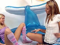Watch these naughty blonde teens getting really wet as they play with one another in this hot lesbian scene.