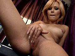 Take a look at this hot solo scene where this horny blonde babe fingers her wet pussy on a chair while wearing high heels as she moans.