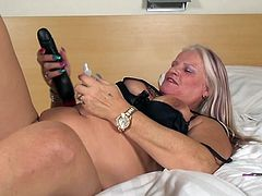 Lizzy is a mature blonde with a crave for sexual satisfaction. This bitch has seen a lot of cock and pussy at her times and now she enjoys some special time alone. The blonde laid on her back on the bed, spread her legs and showed us that delicious pussy and then shoved a big dildo in it. Oh yeah!