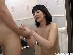 Entertain yourself by watching this Asian brunette, with a nice ass wearing a cute shirt, while she gets fucked hard after giving a handjob.