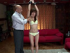 Rina Rukawa is tied up for a hot and oiled pussy sex toy insertion by a bald guy. This Japanese chick's juicy tits are rubbed down and her wet pussy gets fucked by a vibrator.