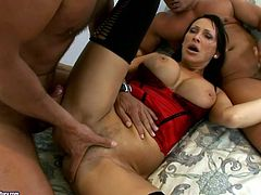 Busty skank Mandy Bright takes part in a threesome