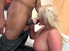 The beautiful blonde MILF Julie Cash gets her yummy round ass covered with cum after gobbling a big black cock and and riding it like a beast.