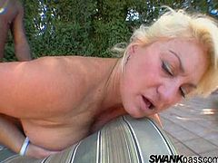 Blonde in white t-shirt swallows easily a heavy cock before getting her shaved pussy in a nasty pounding till she yells out