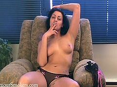 Take a look at this brunette's perfect breasts in this solo scene while she wears a sexy thong and has a smoke while sitting on a couch.