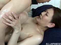 Take a nice look at this Asian MILF, with natural jugs and a nice ass, while she gets drilled hard covered in soap and moans loudly.