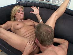 Horny blond mom Ginger Lynn, wearing a bikini, is playing dirty games with a man indoors. She works on the stud's prick, after that they fuck in the cowgirl and other positions.