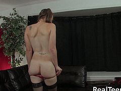 Witness this clip where an amateur babe in pigtails, with natural boobs wearing a thong, rubs