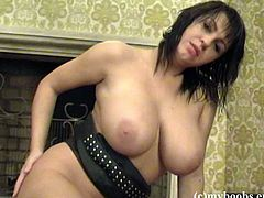 Hot brunette Kora Kryk, wearing a leather outfit and stockings, is getting naughty in the living room. She shows her massive natural jugs and plays with them. After that she also shows her shaved coochie.
