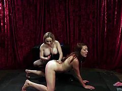 Aiden disciplines her younger gf, Lexis. She puts her to stay down on her knees and to suck her strapon. Then, the busty blonde bends her over, grabs her by the hair and pounds her pussy. Lexis loves it and moans like a whore as the blonde goes deep in her womb. Find out what these whores will do next.
