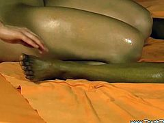These sexy lesbians want to explore some new tantric massage techniques. The ebony is covered with oil and her sexy brunette friend starts to masturbate her snatch.