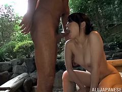 Check out this hardcore scene where this horny Japanese babe sucks a guy's cock before being fucked on a hot spring scenery.